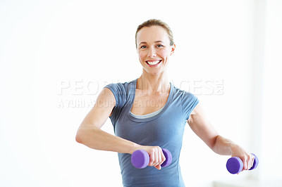 Buy stock photo Portrait of a happy young woman lifting weights