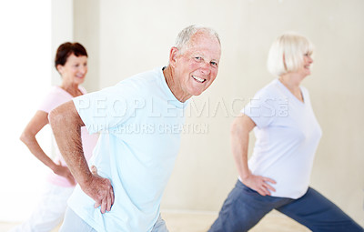Buy stock photo A group of elderly people stretching their legs together