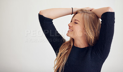 Buy stock photo Shot of a beautiful woman posing indoors