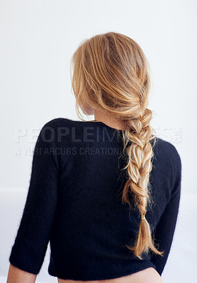 Buy stock photo Rearview shot of woman with a plaited hairstyle