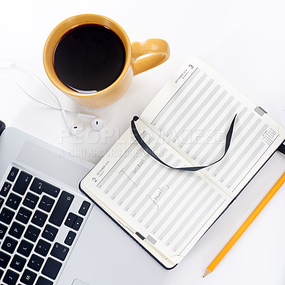Buy stock photo Shot of a laptop and coffee mug on a table