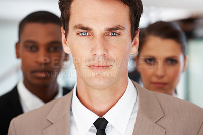 Buy stock photo Portrait of a serious young business manager in office leading his team