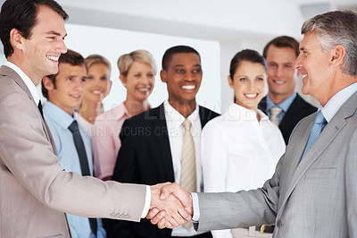 Buy stock photo Happy businessman partners shaking hands with colleagues in background -  Deal