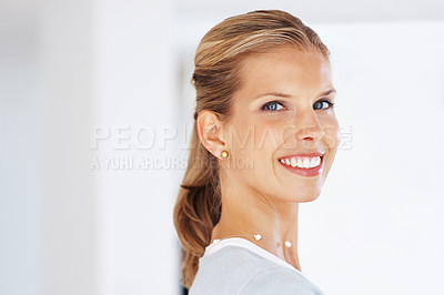 Buy stock photo Portrait of a sucessful young businesswoman smiling at work