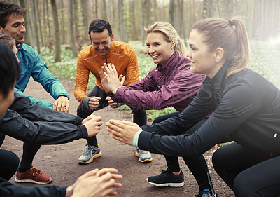 Buy stock photo Shot of a group of friends working out in the park