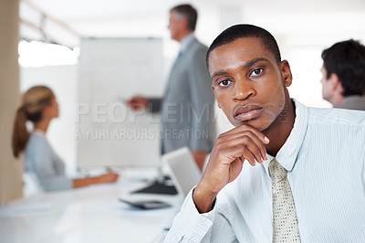 Buy stock photo Portrait of confident young businessman sitting in a meeting at office