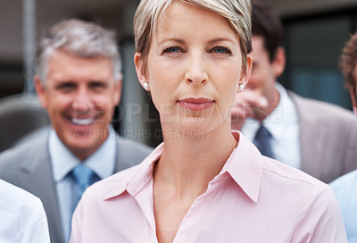 Buy stock photo Portrait of a confident young businesswoman leading her successful team