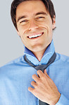 Closeup of a happy successful business man wearing a necktie