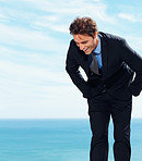 Successful young business adult laughing by the sea