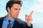 Business authoritative- Young serious man pointing his finger
