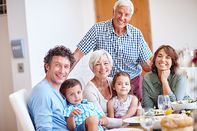 Buy stock photo Shot of a multi-generational family having a meal together