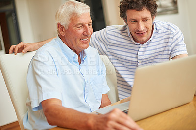 Buy stock photo Shot of a man and his father using a laptop indoors