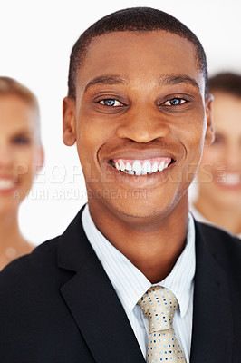 Buy stock photo Portrait of a happy young black businessman in suit leading his team