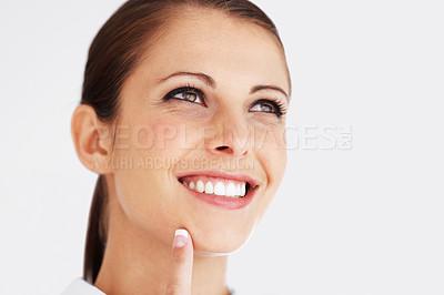 Buy stock photo Closeup portrait of a beautiful young woman looking away at copyspace