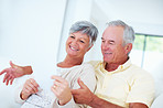 Cheerful mature couple discussing bills