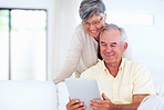 Mature couple using tablet PC