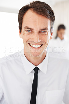 Buy stock photo Portrait of a confident young male business executive smiling at office