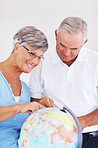 Couple searching travel destination on globe