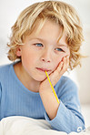 Closeup of an ill boy with thermometer in his mouth