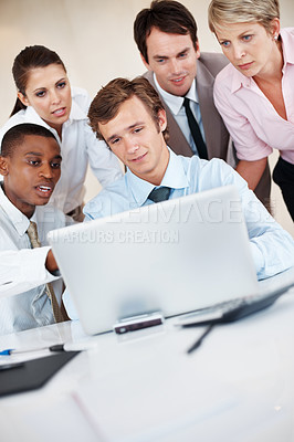 Buy stock photo Portrait of group of people discussing something shown on laptop