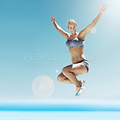 Buy stock photo Shot of a young woman in workout gear jumping in the air