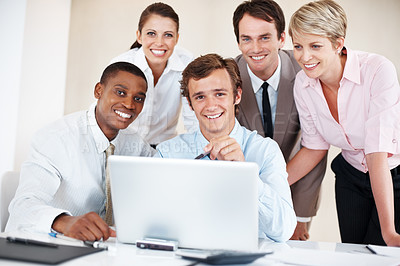 Buy stock photo Group of diverse young business people smiling together with a laptop