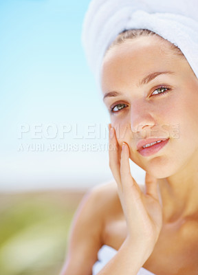Buy stock photo Charming young woman after her bathy feeling her skin