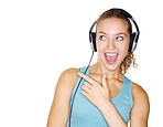 Young female enjoying music over headphones against white