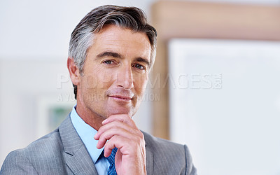 Buy stock photo Portrait of a confident-looking mature businessman with his hand on his chin
