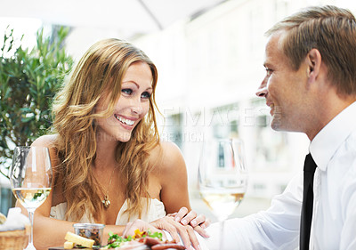 Buy stock photo A woman with cosmetic enhancements admiring her boyfriend in a restaurant