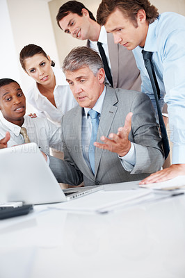 Buy stock photo Portrait of a senior manager discussing new project ideas with his colleagues