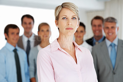 Buy stock photo Portrait of a successful young businesswoman looking with an attitude and her colleagues standing behind at office