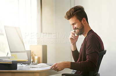 Buy stock photo Shot of a businessman talking on his cellphone while looking at paperwork in his office