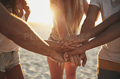 Buy stock photo Shot of a group of young friends piling their hands together