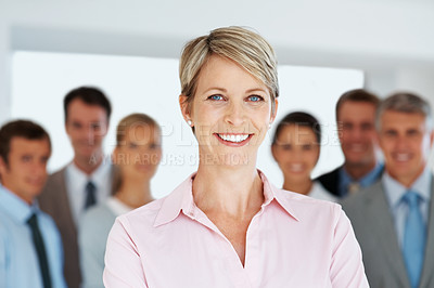 Buy stock photo Portrait of a pretty business woman smiling with colleagues in background