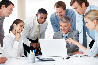 Buy stock photo Group of a successful business people working together on laptop in office