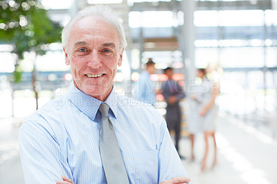 Buy stock photo Portrait of a mature businessman standing indoors