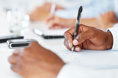 Buy stock photo Cropped image of hand of businessman wrtting notes in a meeting at office