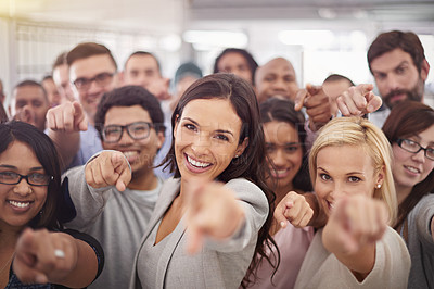 Buy stock photo Portrait of a group of smiling businesspeople pointing at the camera