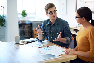 Buy stock photo Cropped shot of two coworkers having a discussion in the office