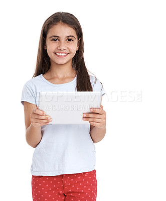 Buy stock photo A little girl using a digital tablet against a white background