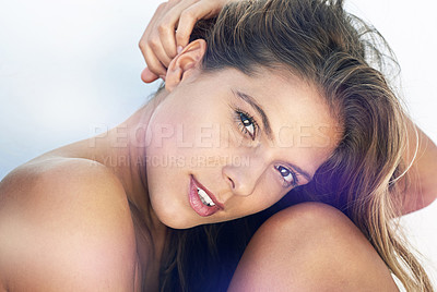 Buy stock photo Cropped portrait of a young woman sitting against a white wall