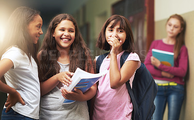Buy stock photo Shot of a young girl getting teased at school