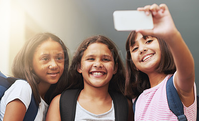 Buy stock photo Three school friends taking a self-portrait with their smartphone
