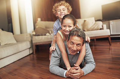 Buy stock photo Shot of a grandfather and his two grandchildren at home