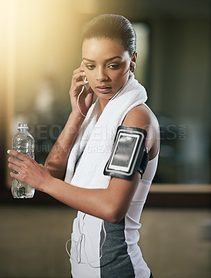 Buy stock photo Shot of a young woman exercising at the gym