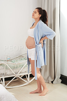 Buy stock photo Shot of a pregnant woman suffering from back pain