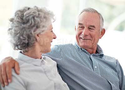 Buy stock photo Cropped shot of an affectionate senior couple at home