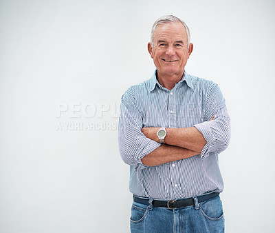 Buy stock photo Cropped portrait of a senior man standing against a white background