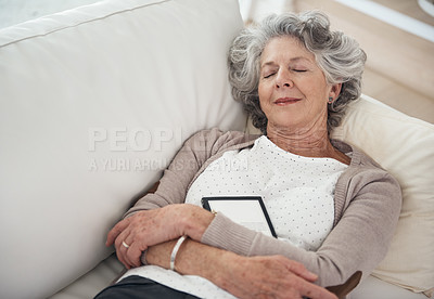 Buy stock photo Shot of a senior woman taking a nap on the sofa at home